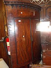 George III mahogany bow front hanging corner cabinet