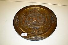 19th Century bronzed electrotype wall plaque decorated in relief with a scene depicting Adam and Eve, unmarked, possibly Elkington, 13ins diameter