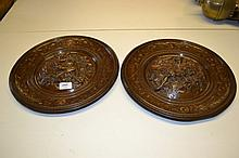 Pair of 19th Century Elkington & Co. bronzed electrotype wall plaques decorated in high relief with classical allegories, signed in the metal Elkington & Co. RD No.s 95091 and 95092, 14.25ins diameter