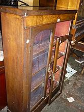 Victorian walnut and marquetry inlaid bookcase with two glazed panel doors above a plinth (a/f)