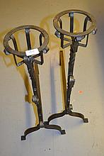 Pair of antique style 20th Century wrought iron fire dogs with basket tops and scroll work hooks