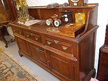Mid 18th Century oak dresser, the low single shelf back above three drawers and two fielded panel doors flanking a fixed centre panel raised on bracket feet