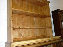 Late 19th / early 20th Century stripped and polished pine dresser having boarded shelf back above two drawers and two panelled doors