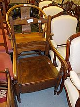 Early 20th Century stained beech commode chair together with a 20th Century fireside chair