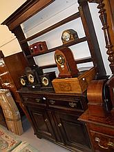 Mid 18th Century oak dresser with open rack having three shelves over two short drawers with brass swan neck handles and a further two fielded panelled doors on bracket feet