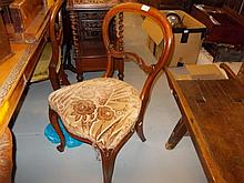 Set of four 19th Century walnut balloon back dining chairs with overstuffed seats on carved cabriole supports