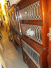 Globe Wernicke type mahogany four section bookcase with leaded glass doors together with a matching narrow bookcase