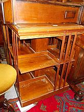 Late 19th or early 20th Century walnut revolving bookcase with slatted sides and crossover base