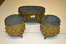 Garniture of three Victorian gilt brass jardinieres with embossed stylised decoration with original liners