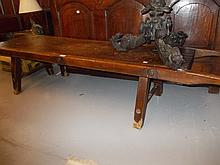 18th / 19th Century elm hog bench with shaped end carrying handles and splay supports