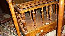 Victorian figured walnut three division Canterbury with single drawer brass handles and turned tapering supports