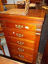 Late Victorian walnut six drawer Wellington type chest with brass handles and side locking mechanism above a plinth base