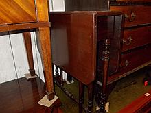 Edwardian mahogany Sutherland table on twin turned end supports united by a turned stretcher