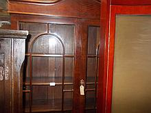 Mahogany bookcase circa 1930 with two glazed doors above two cupboard doors