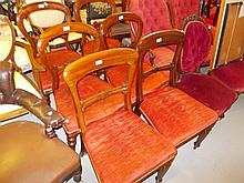 Harlequin set of six (four plus two) Victorian balloon back dining chairs with carved centre rails, overstuffed seats and turned supports