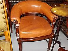 Victorian leatherette upholstered tub shaped chair raised on turned tapering mahogany supports with a loose seat cushion