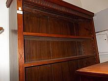 Edwardian walnut open bookcase with three shelves on a plinth base