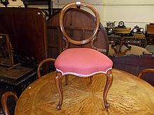 Set of six Victorian walnut balloon back dining chairs with overstuffed seats, raised on cabriole front supports