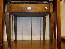 Edwardian beechwood piano stool, two rectangular oak trays and a mahogany bookrack