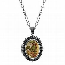 A VICTORIAN STYLE STERLING SILVER LOCKET AND CHAIN; featuring a flower fairy elf.