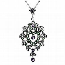 A VICTORIAN STYLE STERLING SILVER PENDANT; set with amethysts, emeralds and seed pearls.