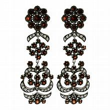 A PAIR OF VICTORIAN STYLE STERLING SILVER DROP EARRINGS; set with garnets and seed pearls. Length 48mm.
