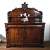 A Victorian carved mahogany chiffonier with shelf above panelled doors, Width 136cm
