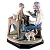 A Lladro figural group of Guiseppe the puppet maker making a wooden puppet of Pinocchio. Reference no. 5396.