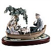A large Lladro figural group of a romantic couple boating near a willow tree, printed marks to base.