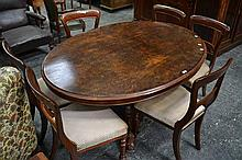 A Victorian Carved Burr Walnut Loo Table with Oval Top and Pedastle Base