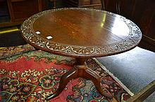 A 19th Century Carved Oak and Elm Wine Table with Tilt Top Action and Pedestal Base
