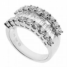 18CT WHITE GOLD LARGE BAGUETTE & BRILLIANT CUT DIAMOND BAND.