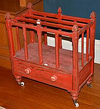 A RED DISTRESSED SINGLE DRAWER CANTERBURY ON CASTERS
