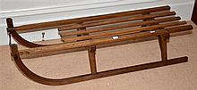 AN ANTIQUE TIMBER SLEIGH, GERMAN