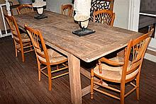 A LARGE AND RUSTIC FARMHOUSE TABLE, SEATS 10 H: 79CM W: 289 CM D:100 CM