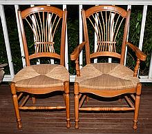 A SET OF SIX COUNTRY STYLE DINING CHAIRS WITH REEDED SEATS (INCLUDES TWO ARMCHAIRS)
