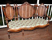 AN ANTIQUE VICTORIAN 3 SEATER BENTWOOD COUCH WITH CANED PANELLED BACK AND SEAT C. 1890S