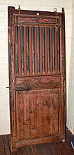 AN ANTIQUE INDONESIAN DOOR H: 181CM