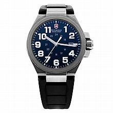 A VICTORINOX SWISS ARMY CONVOY WRISTWATCH; black dial with luminescent Arabic Numerals and day date at 3, stainless steel case with...