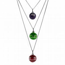 THREE ENAMELLED STERLING SILVER HARMONY BALLS; 18.3-19.7mm round pendants in purple red and green on 925 silver chains
