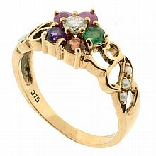 A 9CT ROSE GOLD GEM SET REGARD RING; floral design set with ruby, emerald, garnet, amethyst, ruby and diamond with seed pearls to sc...