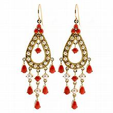 A PAIR OF 9CT GOLD PEARL AND CORAL DROP EARRINGS; each a pear shape gold drop set with 3 corals breads and seed pearls suspending a...