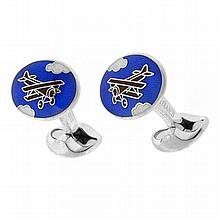 A PAIR OF ENAMELLED HALLMARKED STERLING SILVER CUFF LINKS; oval plaques with enamelled bi-plane design by Deakin & Francis