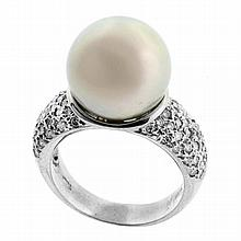 A SILVER TAHITIAN PEARL AND DIAMOND RING; set in 18ct white gold with a 12.4mm round silver Tahitian pearl of good lustre to shoulde...