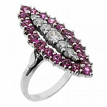 A PINK SAPPHIRE AND DIAMOND MARQUISE RING; claw set in 18ct white gold with a line of graduated round brilliant cut diamonds, centre...