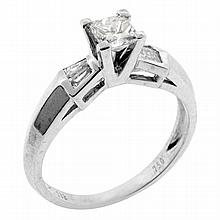 AN 18CT WHITE GOLD SOLITAIRE DIAMOND RING; four claw set with  Princess cut diamond of approx 0.45ct VVS2/I to shoulders channel set...