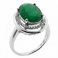 AN EMERALD AND DIAMOND RING; claw set in 18ct white gold with oval cut emerald of approx 2.98ct, small chip to girdle encircled by 3...
