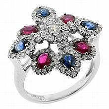 AN 18CT WHITE GOLD DIAMOND AND GEM SET RING; claw set in a stylised flower design with 4 pear cut sapphires 4 oval cut rubies and 11...