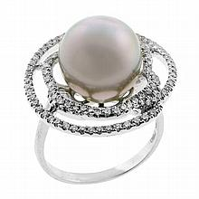 A SILVER PEARL AND DIAMOND RING; set in 18ct white gold with a round silver South Sea pearl of good lustre with moderate blemishes e...
