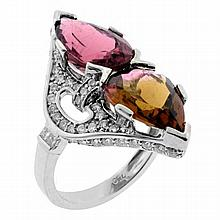 A TOURMALINE AND DIAMOND DRESS RING; set in 18ct white gold with a pear cut light pink Rubellite tourmaline of approx 3.18ct and a p...